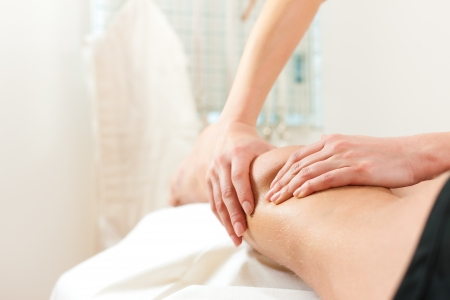 therapist: Patient at the physiotherapy gets massage or lymphatic drainage Stock Photo