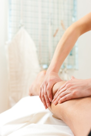 tension: Patient at the physiotherapy gets massage or lymphatic drainage Stock Photo