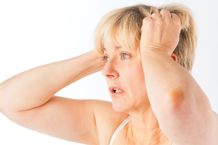 widespread: Medicine and disease - a mature woman with headache or migraine