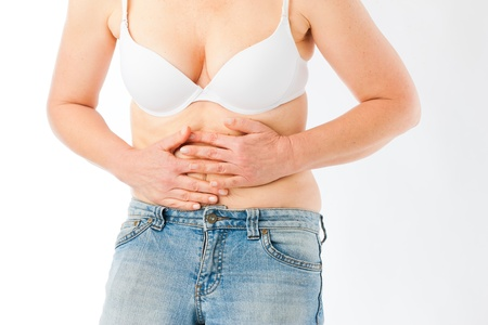 Medicine and disease - a mature woman with stomach pain or abdominal cramps photo