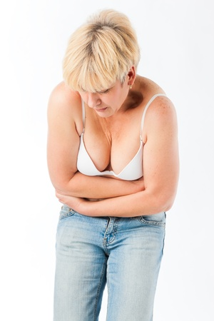 cramps: Medicine and disease - a mature woman with stomach pain or abdominal cramps