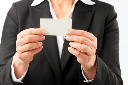 Mature woman showing her business card, closed-up photo