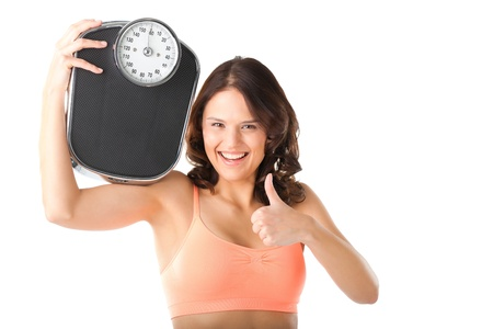 diet woman: Diet and weight - young woman with a scale, she is happy about the success