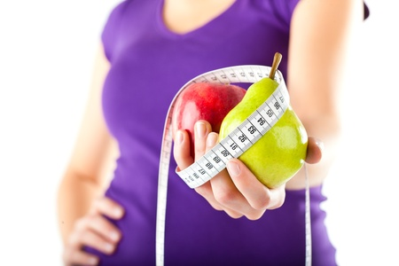 public insurance: Healthy eating - woman with apple and pear and measuring tape Stock Photo