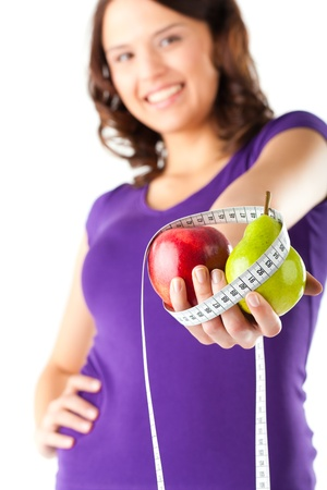 public sector: Healthy eating - woman with apple and pear and measuring tape on diet Stock Photo