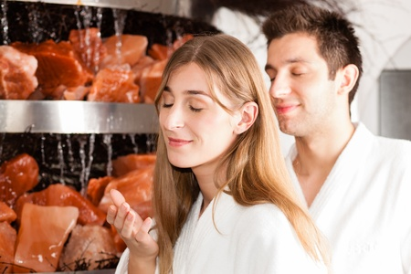 Young couple inhaling essential oil in salt cave of a Spa Stock Photo - 13196733