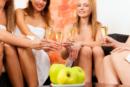 spa towels: Wellness - young, happy female friends drinking champagne in spa and have fun