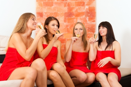 woman towel: Wellness - young, happy female friends drinking champagne in spa and have fun