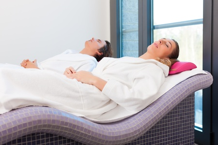 Wellness - a man and a young woman relaxing after sauna, they enjoy the silence Stock Photo - 13319268