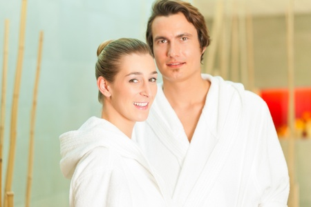 Young couple in bathrobe in Spa, they waiting for a treatment photo