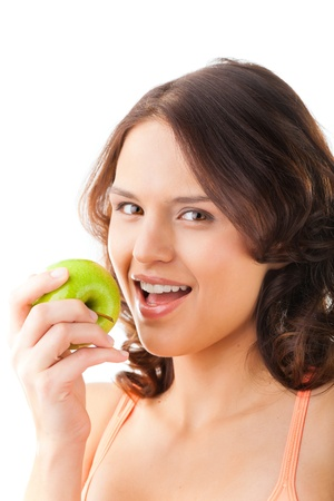 Healthy nutrition and healthy teeth or diet, young woman bites in a fresh apple photo