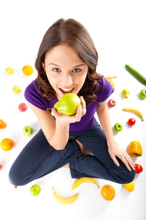 public sector: Healthy eating, happy woman with fruits and vegetables is eating a pear