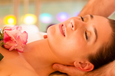 Woman enjoying head massage in a spa with chromatherapy or color therapy Stock Photo - 13319502