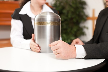 cremation: mortician with client comforting and advising