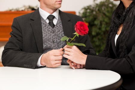 Undertaker is advising a client for the funeral and is giving her solace Stock Photo - 13319455