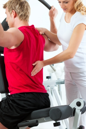 physical: Patient at the physiotherapy making physical exercises with his therapist