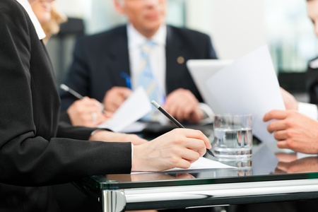 lawyer meeting: Business - meeting in an office, lawyers or attorneys discussing a document or contract agreement Stock Photo