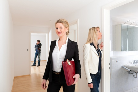 apartment for rent: Real estate market - young couple looking for real estate apartment to rent or buy Stock Photo