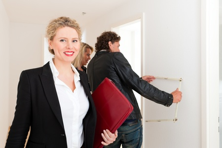 Real estate market - young couple looking for real estate apartment to rent or buy Stock Photo - 13452817