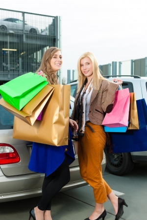 Two women were shopping in a mall or shopping centre and driving home now with their car Stock Photo - 13452853