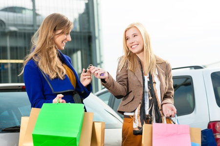 shopping centre: Two women were shopping in a mall or shopping centre and driving home now with their car