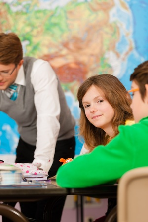 Education - Pupils and teacher learning at elementary or primary school in the classroom Stock Photo - 13452839