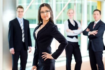 Business - group of businesspeople posing for group photo in office photo