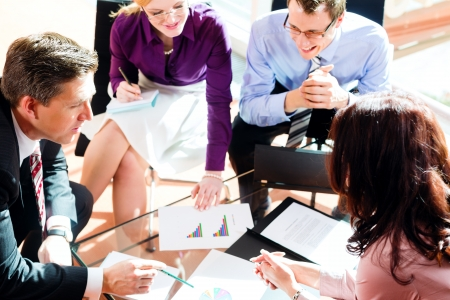 Business people having meeting or workshop in office checking profit growth graph and documents Stock Photo - 13452912