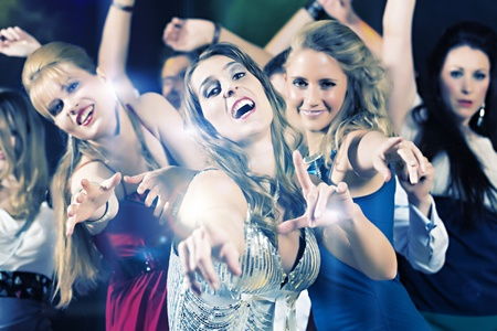 prom dress: Young people dancing in club or disco party, the girls and boys, friends,  having fun