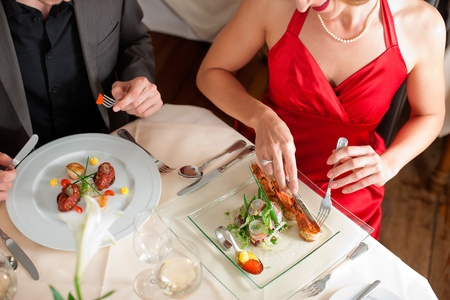 High angle view of couple having food at a restaurant photo