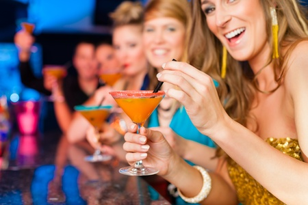 Young people in club or bar drinking cocktails and having fun Stock Photo - 13494333