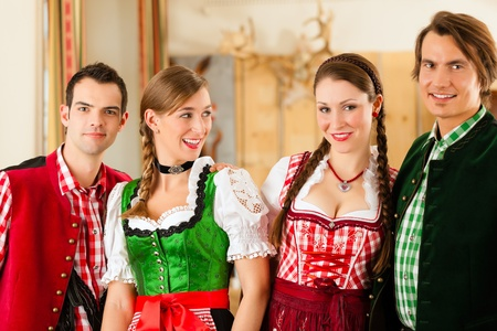 clique: Young people in traditional Bavarian Tracht in restaurant or pub
