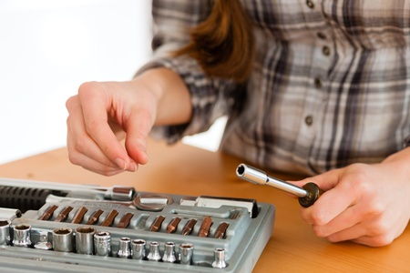 Woman with toolbox and screwdriver - only torso to be seen photo