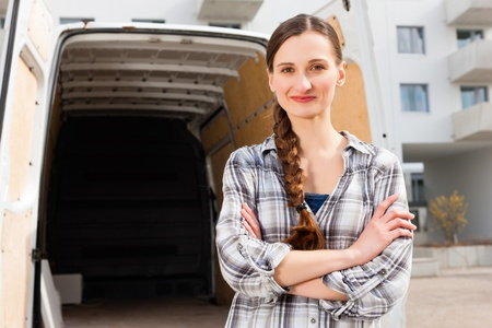 shipper: Young woman in front of moving truck, the van is still empty