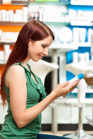 customer in a pharmacy or drugstore is looking for products photo