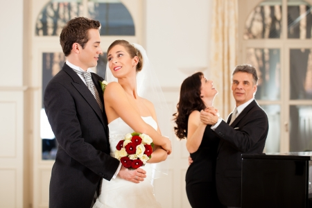 Bride, groom and wedding guests dancing waltz on the wedding day photo
