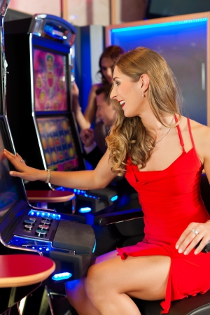 casino machine: Friends in Casino on a slot machine, all obviously are winning