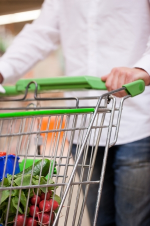 cropped image: Cropped image of man shopping groceries for house