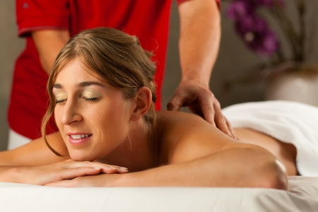 Woman enjoying a wellness back massage in a spa, she is very relaxed  close-up  photo
