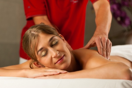 Woman enjoying a wellness back massage in a spa, she is very relaxed  close-up  Stock Photo - 13709034