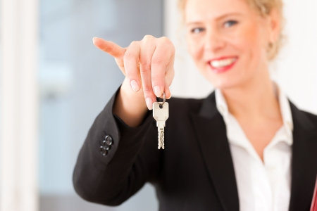 tenant: Young realtor is with keys in an apartment; it could be the tenant too Stock Photo