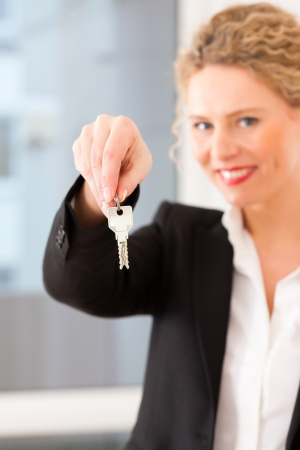tenant: Young realtor is with keys in an apartment, it could be the tenant too Stock Photo
