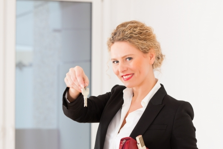 Young realtor is with keys in an apartment, it could be the tenant too Stock Photo - 13708807