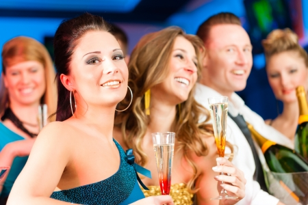 adult birthday: Young people in club or bar drinking champagne and having fun Stock Photo