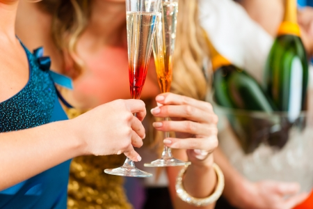 Young people in club or bar drinking champagne and having fun Stock Photo - 13709061