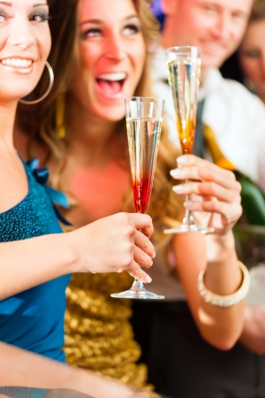 birthday suit: Young people in club or bar drinking champagne and having fun Stock Photo