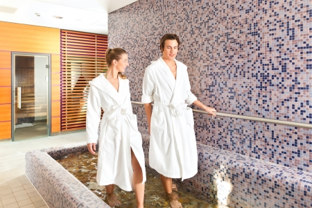treading: Man and woman while wellness water treading or hydrotherapy