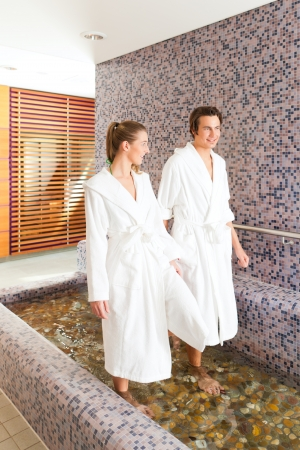 Man and woman while wellness water treading or hydrotherapy photo
