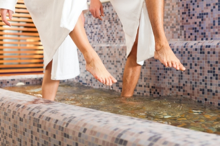 treading: Man and woman while wellness water treading or hydrotherapy, only feet to be seen