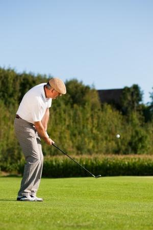 Man playing golf Stock Photo - 14125538